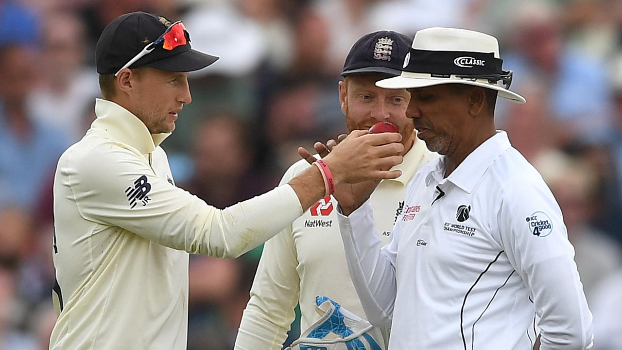 England captain Joe Root holds up the ball for umpire Joel Wilson to smell during day four of the first Ashes Test. Picture: Gareth Copley/Getty Images
