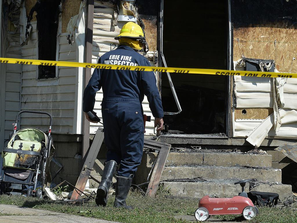 Erie Bureau of Fire Inspector Mark Polanski helps investigate the site of the fatal fire. Picture: AP
