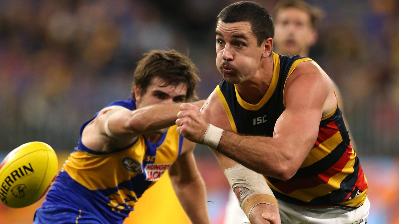 Taylor Walker of the Crows fires off a handball. Picture: Paul Kane/Getty Images