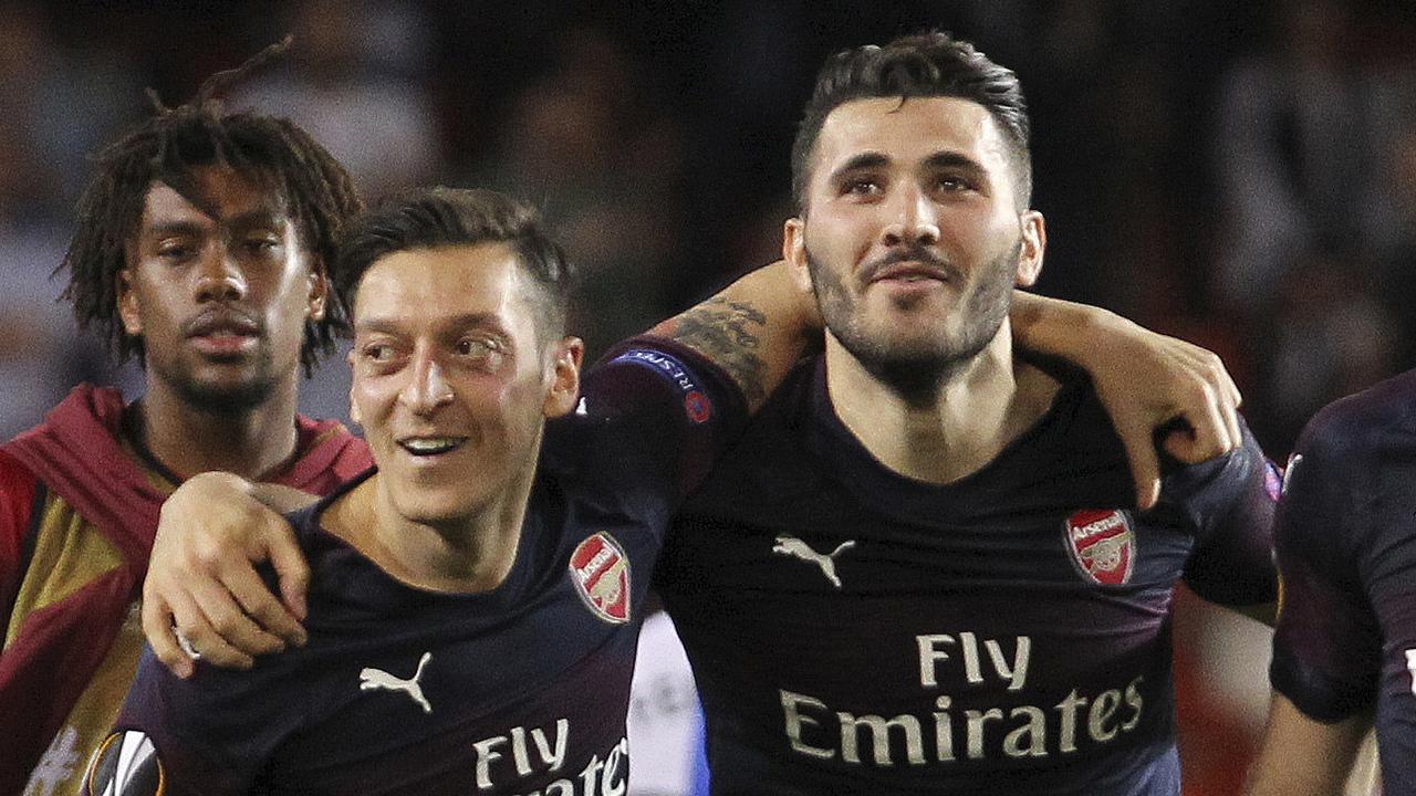 Mesut Ozil and Sead Kolasinac are close friends. Picture: Alberto Saiz/AP