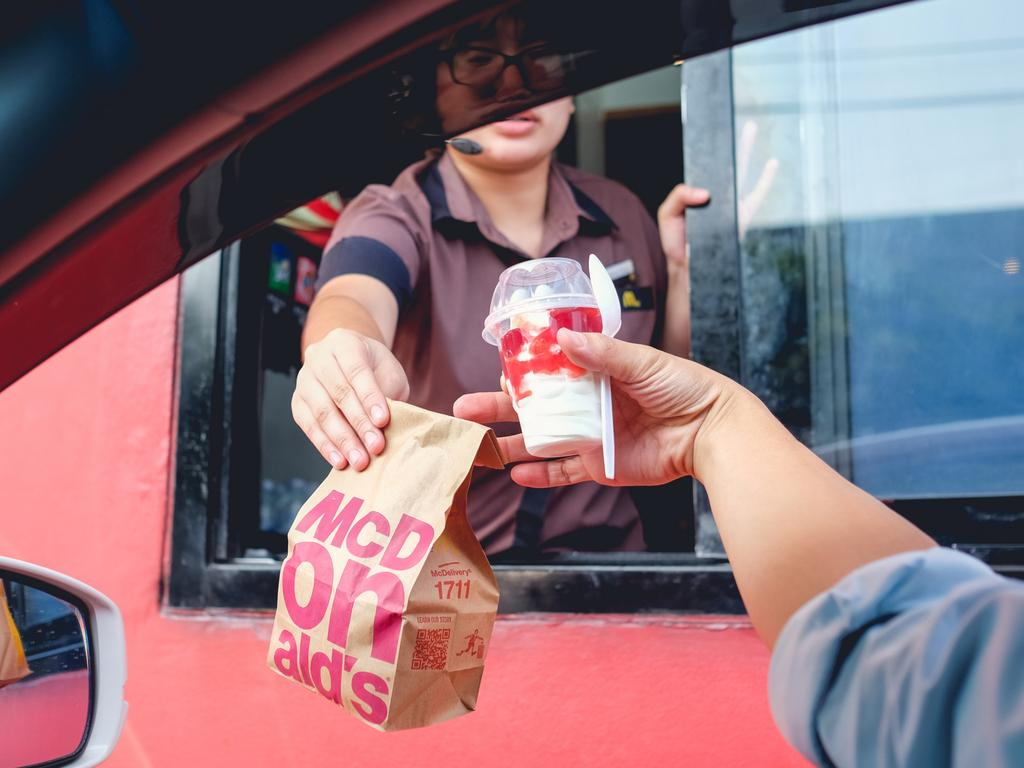 A lot of people wondered if the law around not having any part of your body outside of the car also applied when reaching for your food in a drive-through.