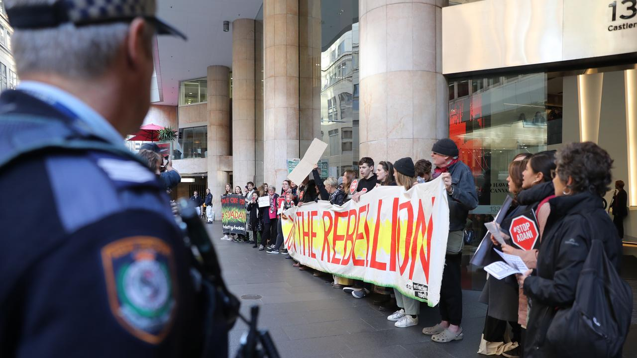 Police watch over the protesters in Sydney on Monday. Picture: John Grainger