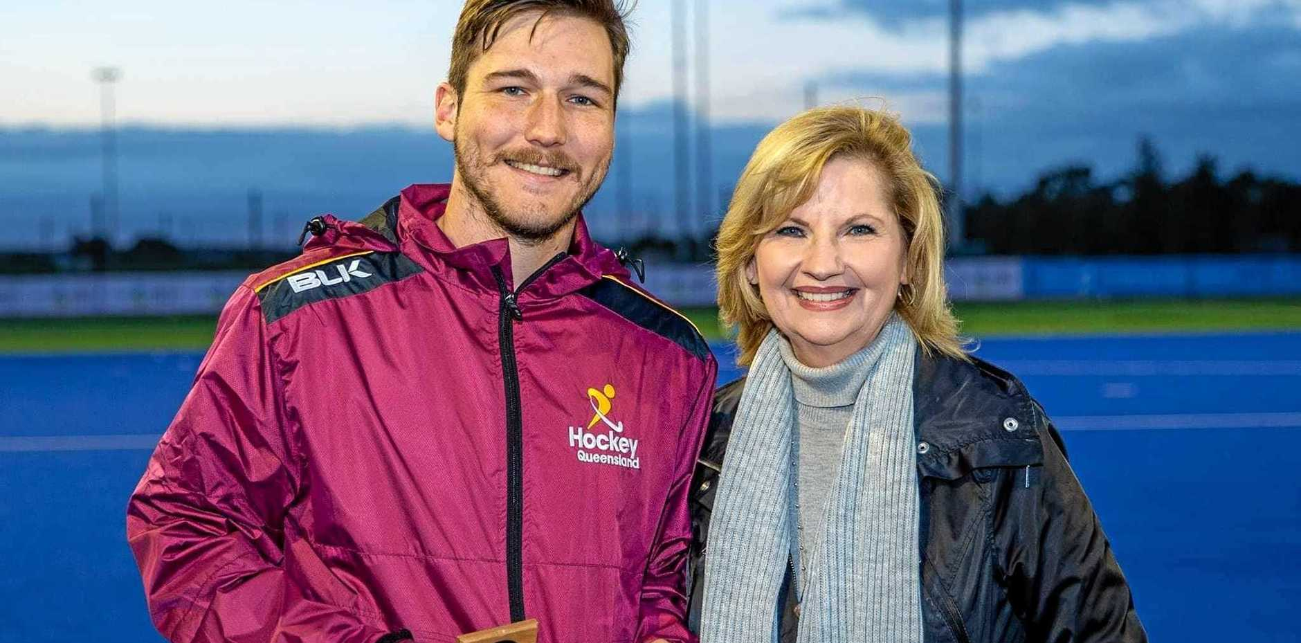STAR MAN: Drew Wenzel, pictured with Shepparton mayor Kim O'Keefe, was named Player of the Tournament at the recent Australian Country Hockey Championships in Shepparton.