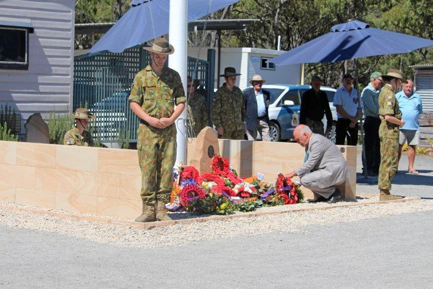 NAMES COMMEMORATED: Livingstone mayor Bill Ludwig lays a wreath at the cenotaph at Cockscomb Veterans Bush Retreat during the Vietnam Veterans Day commemorative service last year.