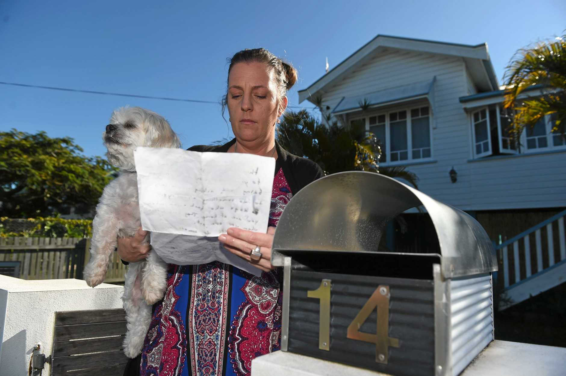 TOO LATE FOR BELLA: Tracey Spoor and her dog Yoppy with the letter she received threatening her dogs and children.