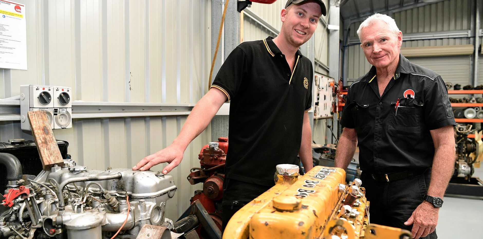 ON THE JOB: First year apprentice Callum McIntosh and Tafe automotive trainer Ian Walsh.