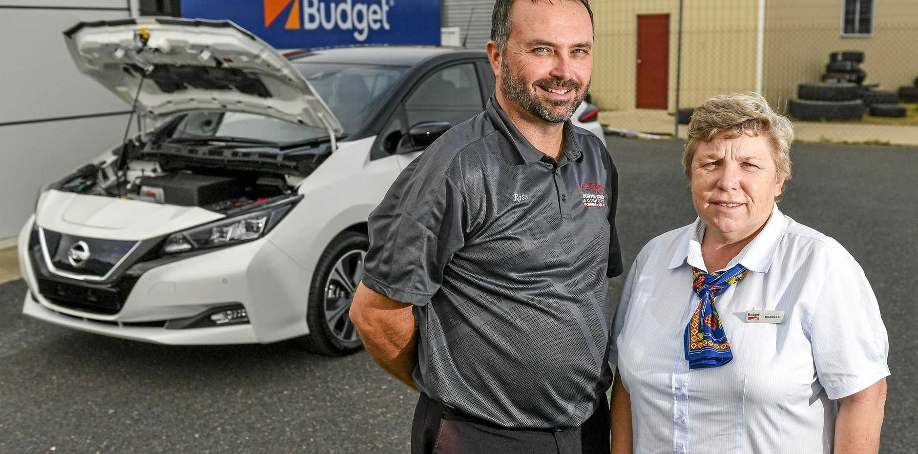 ELECTRIC FEEL: Budget Gladstone manager Michelle Comley and Curtis Coast Automotive dealer principal Ross Turner with the new Nissan Leaf electric car.