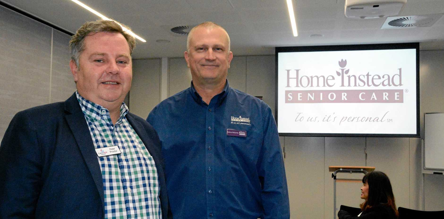 TALKING POINT: Carers Queensland team leader Peter Proctor (left) and Home Instead Client Services representative Andrew McCarthy prepare for the information seminar section at Toowoomba's first death cafe.