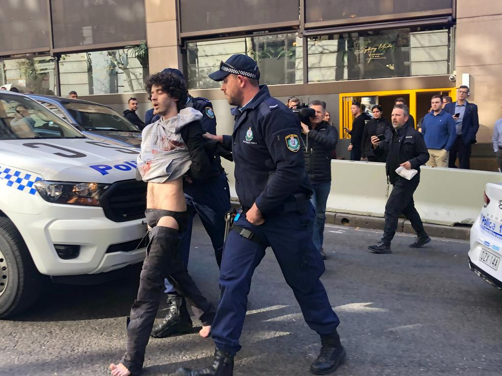 Mert Ney being detained by police. Picture: AAP