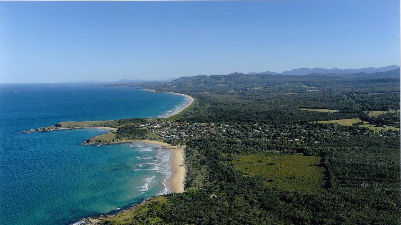 The property, with the township of Emerald Beach visible to the south, is surrounded by protected areas including the Moonee Beach Nature Reserve to the north and Coffs Coast Regional park on the eastern side. Photo: Trevor Veale.