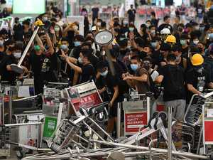 Cairns passengers tell of Hong Kong chaos