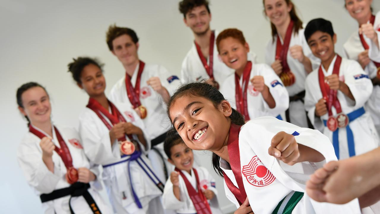 KICK FOR GOLD: Competitors from Sunshine Coast Karate came back with a swag of medals from the Soke Cup in Canada. Pictured foreground, Na'ila Khan. Photo: Patrick Woods