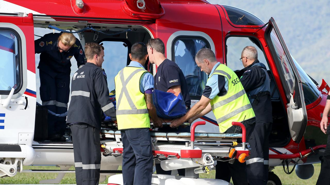 A man in his 20s arrives at Cairns Hospital with serious injuries after becoming crushed between two trucks near Millaa Millaa. PICTURE: ANNA ROGERS
