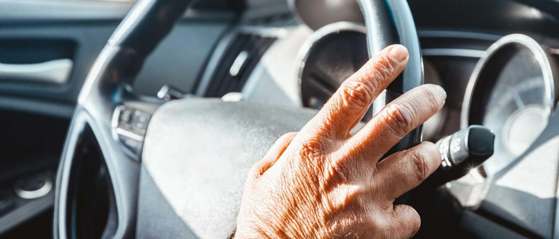 Senior Adult's Hand on the Steering Wheel