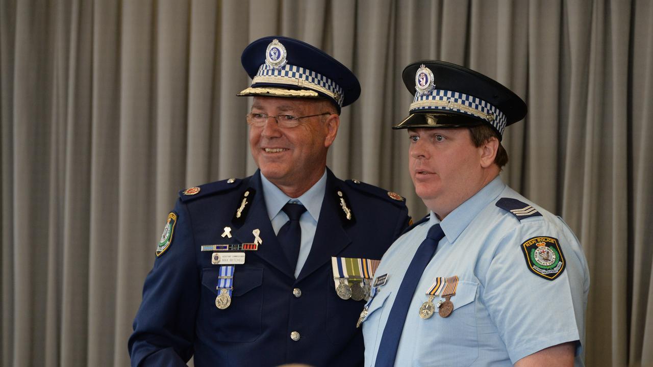 Assistant Commissioner Max Mitchell with Detective Sergeant Aaron Van Schaik.