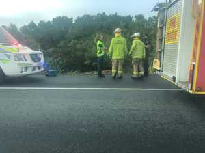 Emergency services have blocked traffic to rescue driver trapped in car