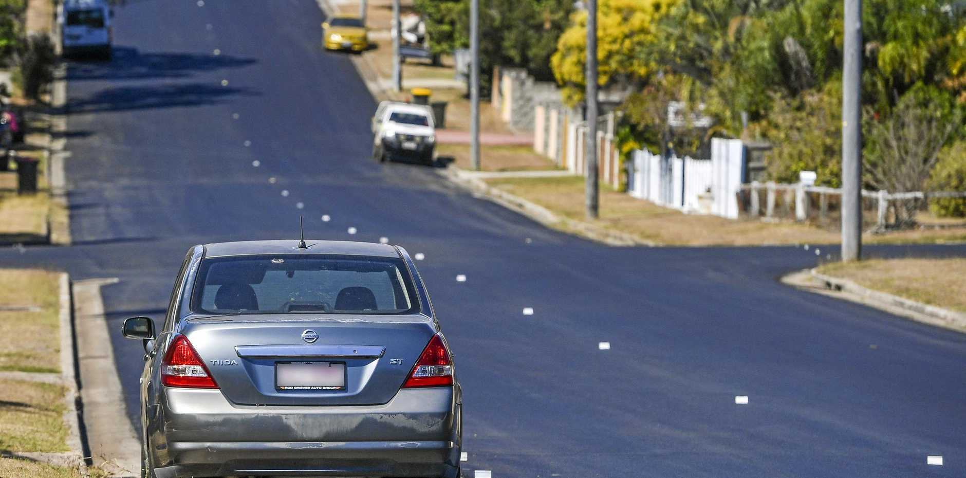 SQUARED OFF: Council workers were forced to bitumen around a car on Auckland St after upgrades were performed on the stretch of road last week.