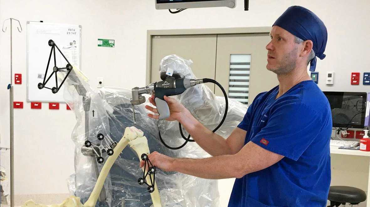 NEW TECH: Dr Alan Loch demonstrates St Vincent's Private Hospital Toowoomba's new orthopaedic robot.