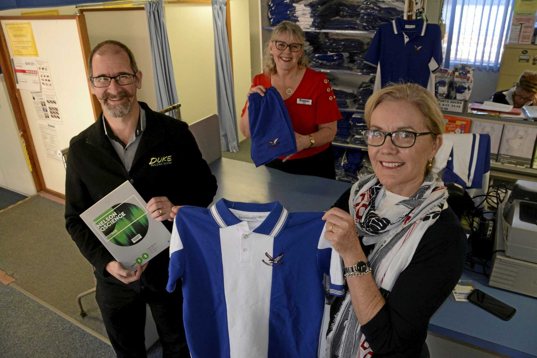 HELPING HAND: Duke Building Design's Colin Duke is the first business to donate to Harristown State High School P&C's Pay-It-Forward Community Chest, developed by volunteer Teena Duke (centre) and operations manager Louise Ryan.