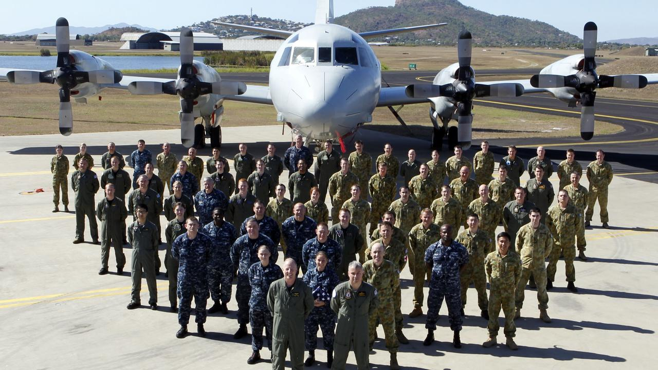 US and Australian military personnel stand together during joint war games but will the alliance last?
