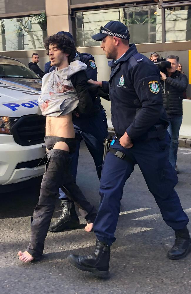 Mert Ney is led away by police after Tuesday's horror attack in the CBD. Picture: AAPA