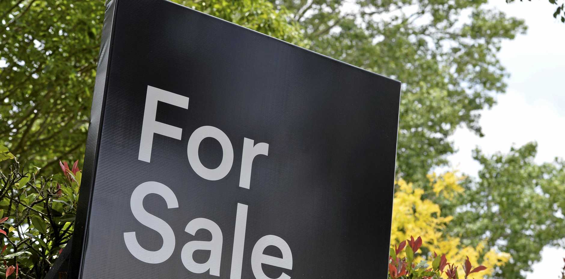 A real estate For Sale sign on a property in East Toowoomba, house for sale, Thursday, December 21, 2017.