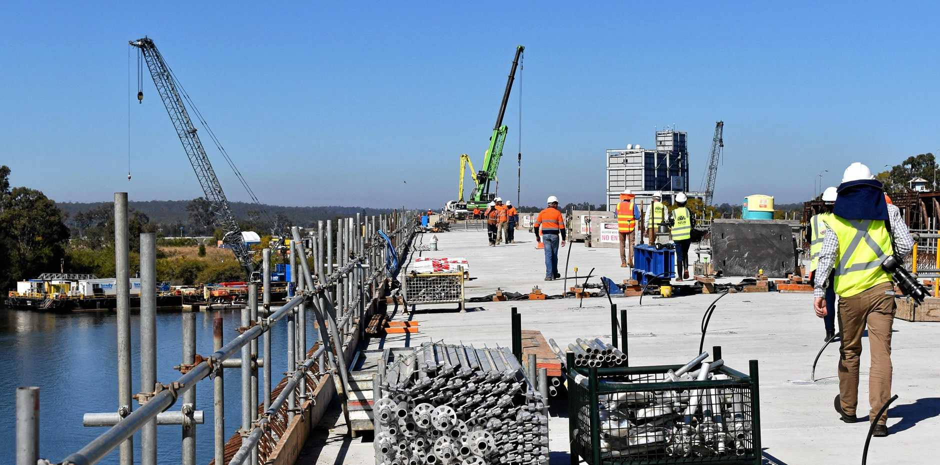 ALMOST THERE: The final segment of the new Grafton bridge has been lifted into place signalling the final stages of its construction.