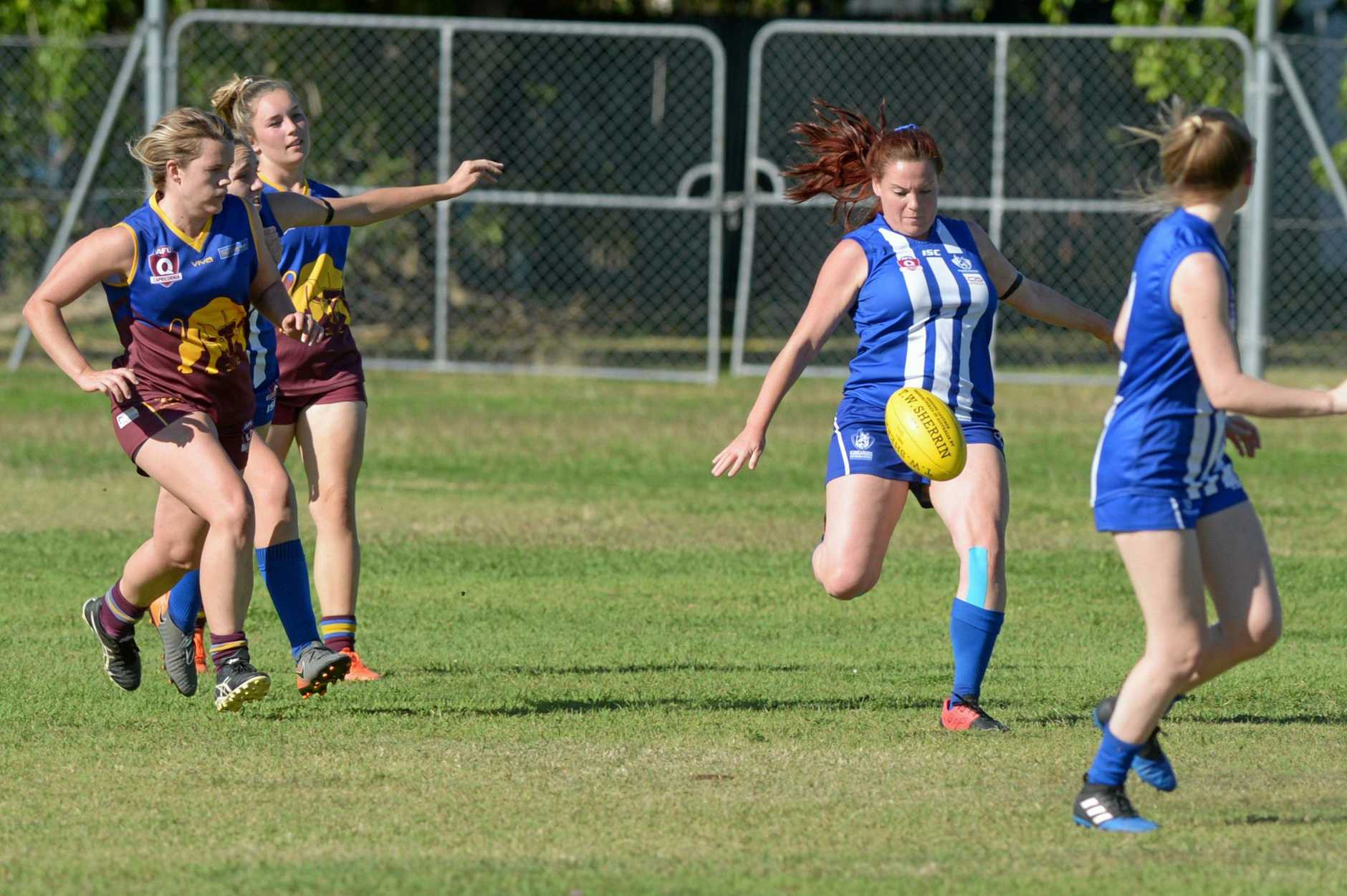 AFL: Brothers' Lisa-Maree Dooley with the ball