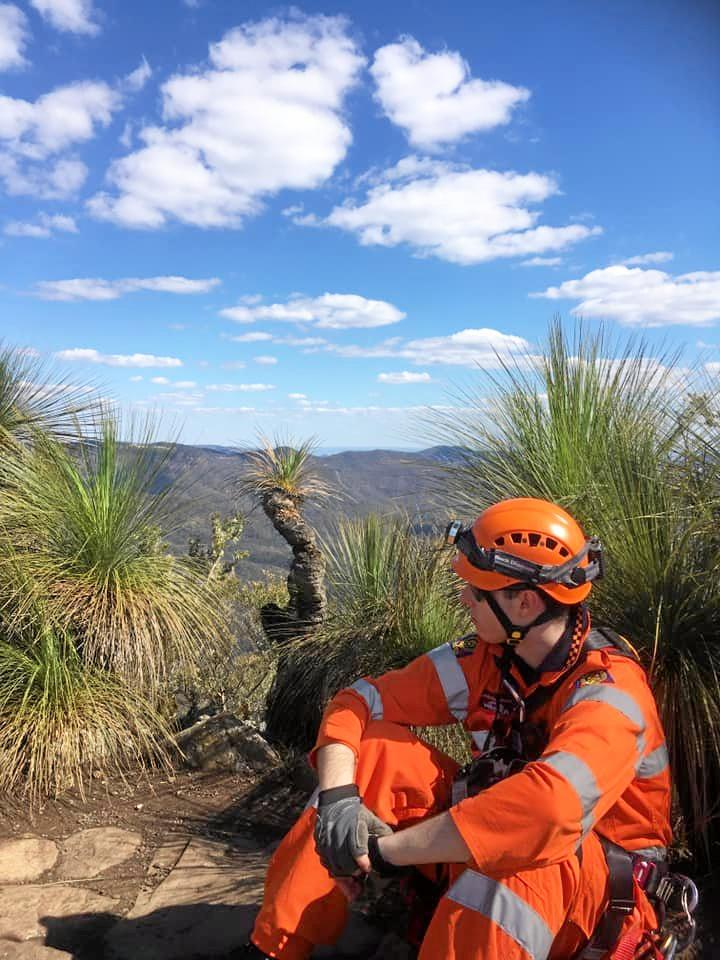 PRECARIOUS SITUATION: QSES officer waits at the summit.