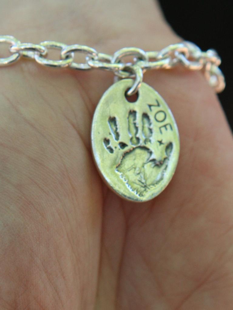 A bracelet bearing Zoe's handprint worn by Brodie Donegan.
