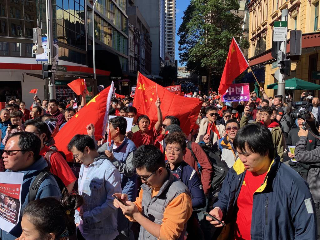 Pro-China activists at a rally along George St, Sydney. Picture: Tim Hunter