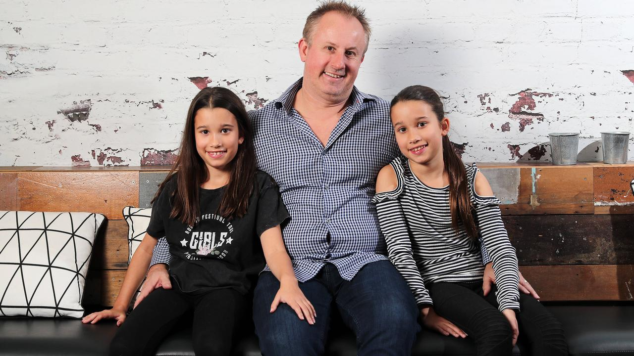 Nova radio's Jay Walkerden with 10-year-old twin daughters Holly and Amelia. Picture: Josh Woning