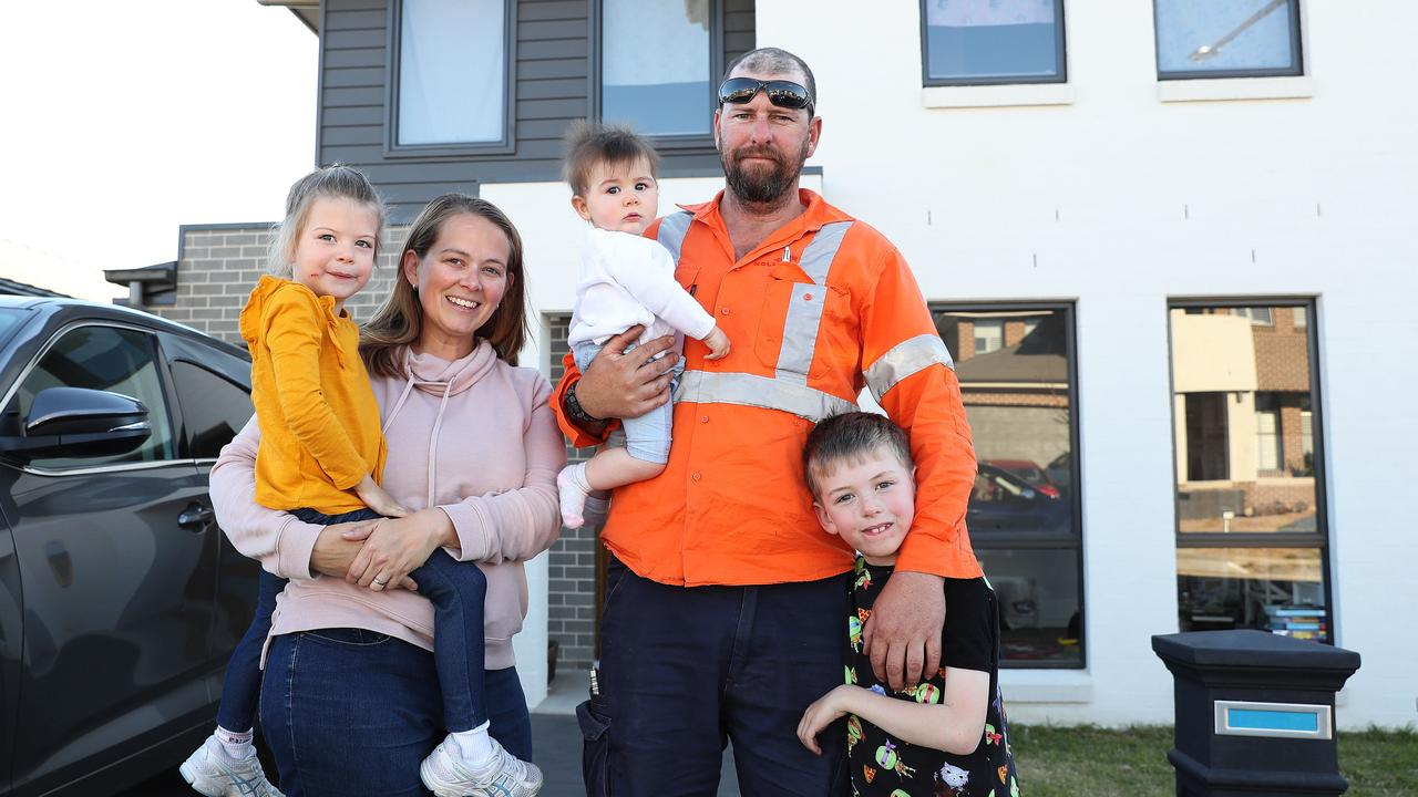 Megan and Dale Howard, with kids Airlie, 4, Emeline, 8 months, and Loki, 7, bought a house in Caddens. Picture: Brett Costello