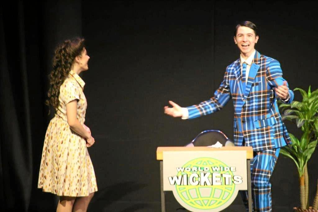 Luca Mella and Madison Day shine in TCC'S performance How to Succeed in Business Without Really Trying in June.