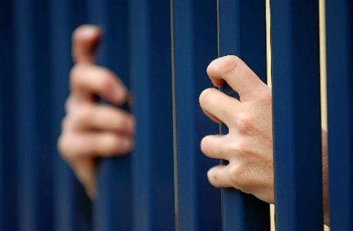 Behind bars generic photo jail.
