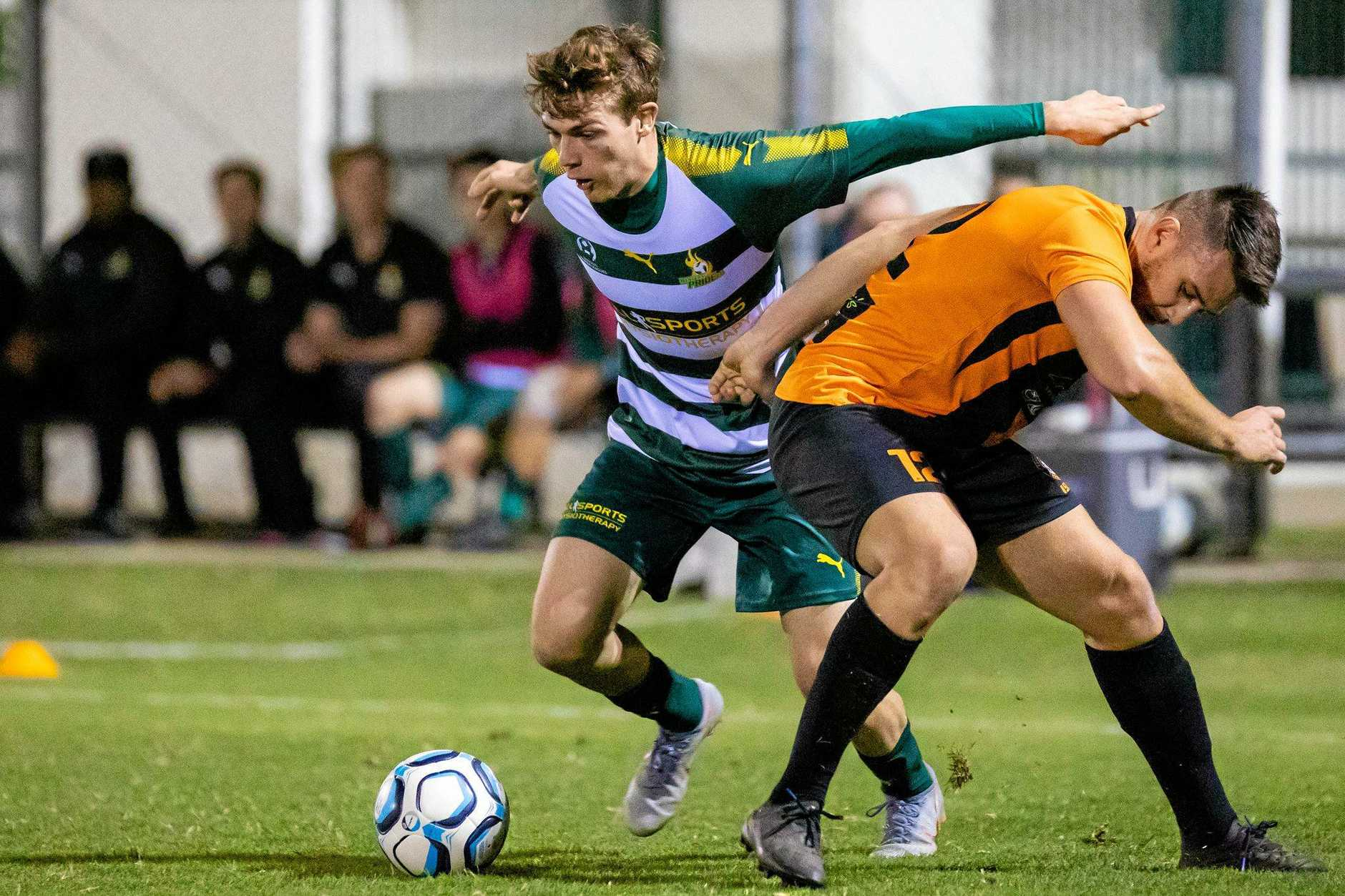 Western Pride striker Alex Parsons works hard for his team in Saturday night's 3-2 victory over Easts.
