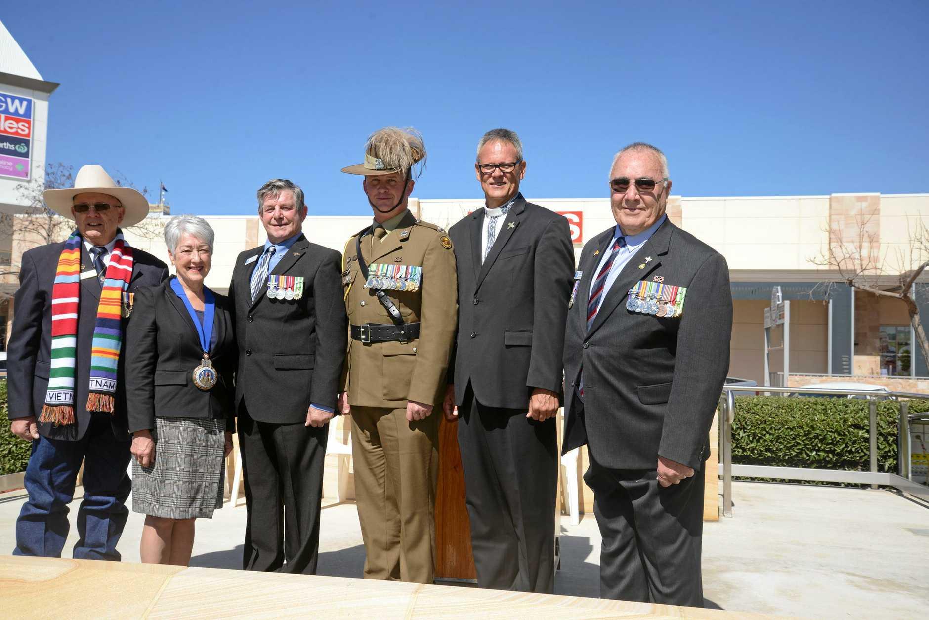 REMEMBERING: John Skinner (Warwick RSL sub branch), Cr Tracy Dobie (SDRC), Ken Ashton (SDESA), Major Grant Prendergast, Rev Willie Liebenberg and Barry Kelly (SDESA) at Leslie Park at the Vietnam Veterans' Day Remembrance Service.