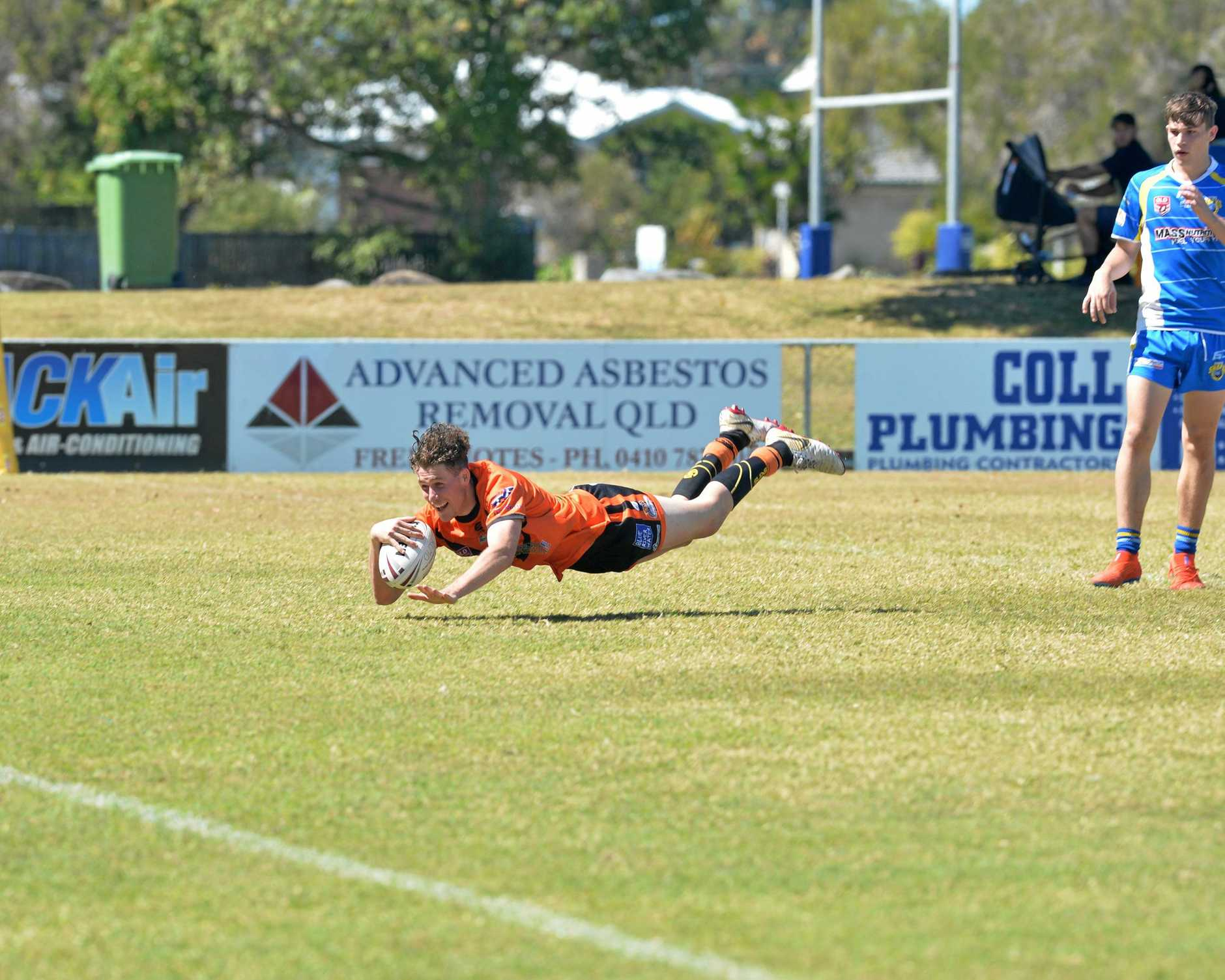 ALL SMILES: Wests Tigers Under-19s player Connor McDermott as he crosses the line and gives his side the lead.