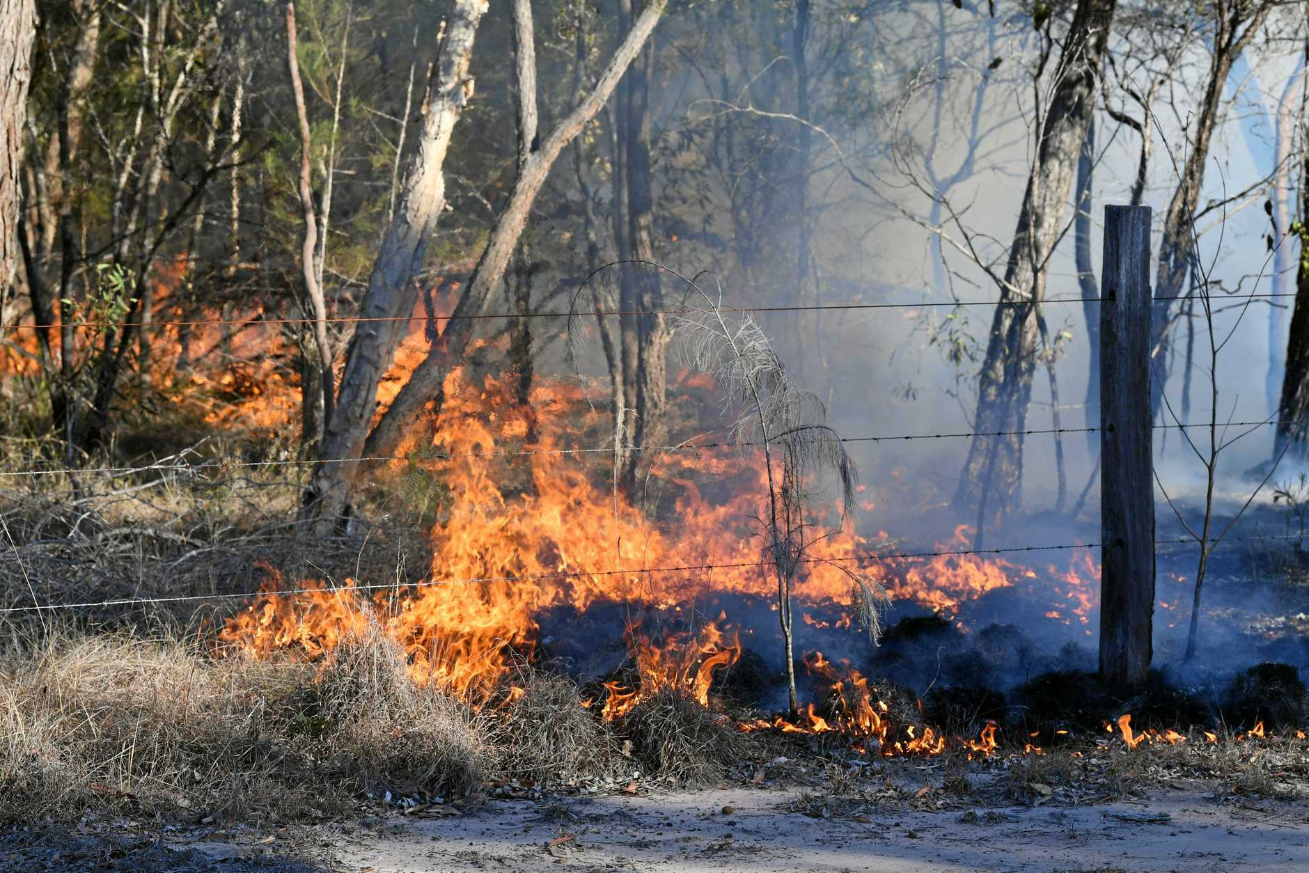 Grass fire on  Toogum Road, near Beelibi Creek.