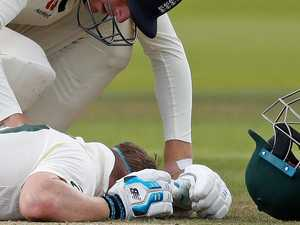 Ashes scare: Steve Smith floored by sickening neck blow