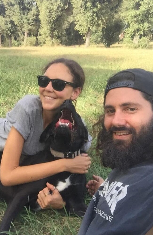 Britt and Jay with Ugo, the pup they're currently house sitting with in Rome. Picture: Supplied.