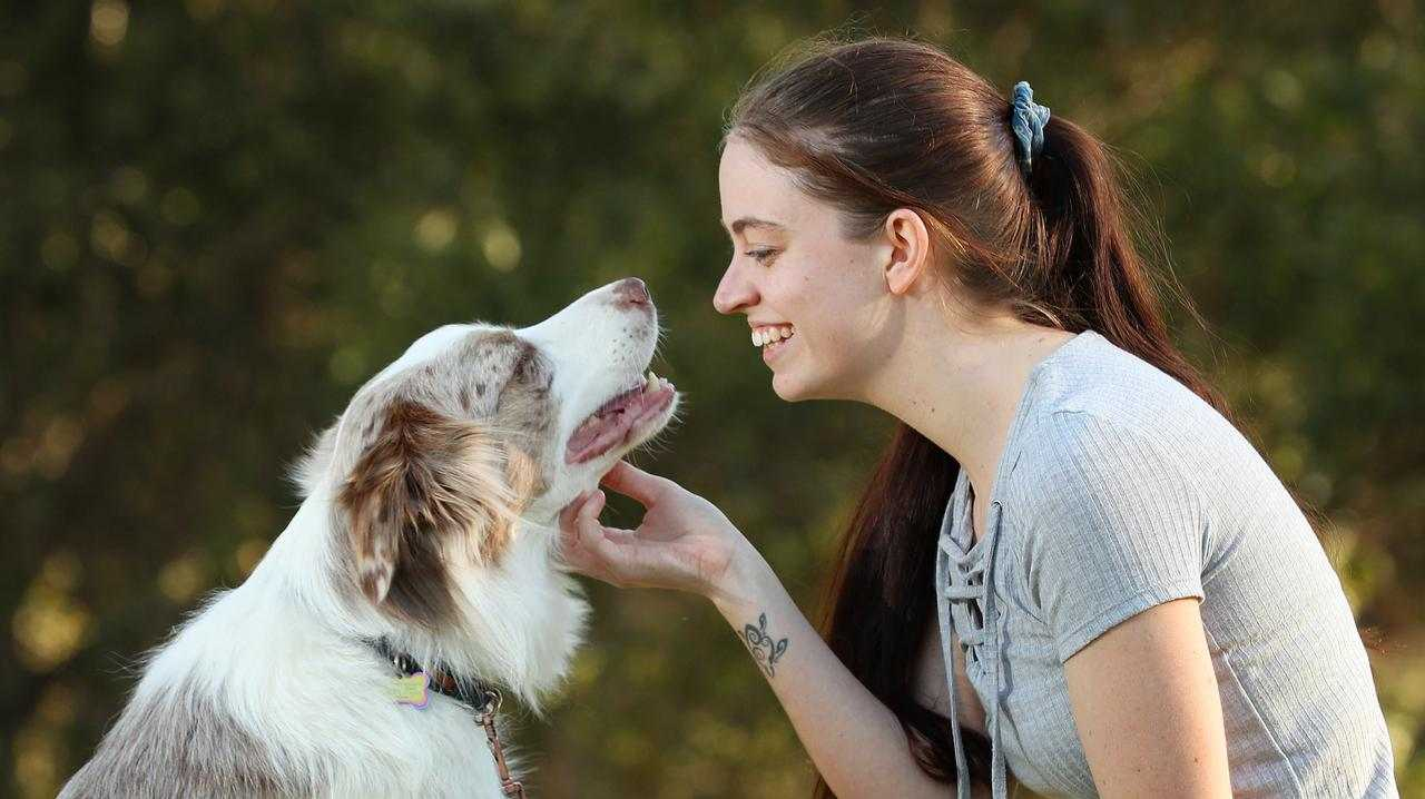 Taylah McKeand, 23, with her dog Mowgli. Picture: Liam Kidston