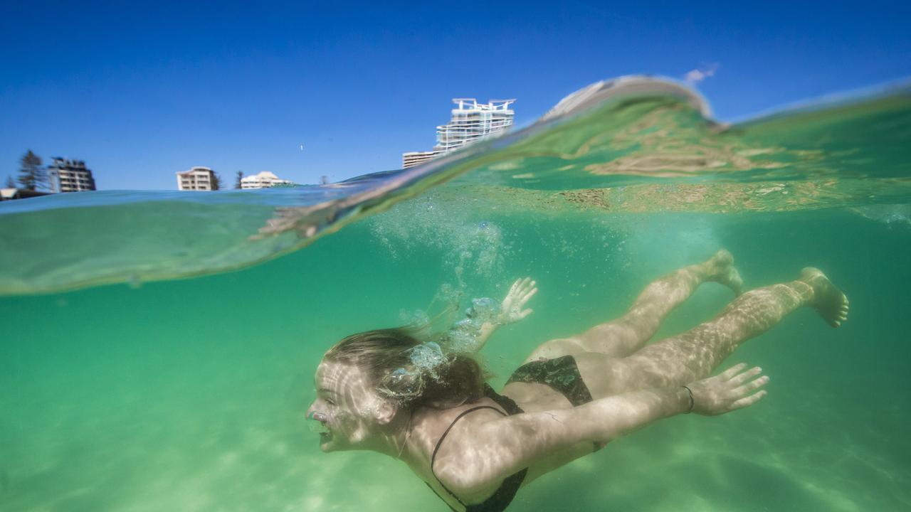 Queensland is enjoying Sunny Warm Winter Days while the southern states are shivering through the end of winter. Hannah Johansson (pictured), 22 from Sweden enjoys sunny Queensland with a swim at Coolangatta beach. Picture: Nigel Hallett