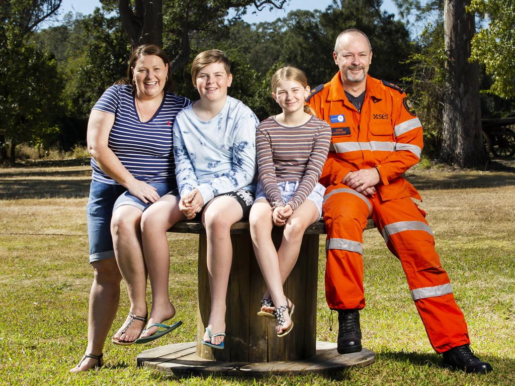 Mum Helen Gallo with her children Zander, 13 and Sienna, 10 with SES volunteer Chris Holloway. Picture: Nigel Hallett