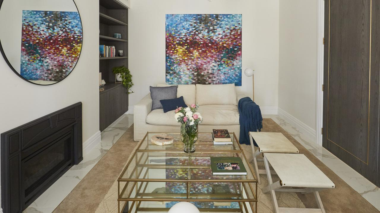 Shaynna 'hated' the perimeter of tiles around Jesse and Mel's formal lounge room prompting Jesse to accuse her of not having 'expensive' taste. Picture: The Block