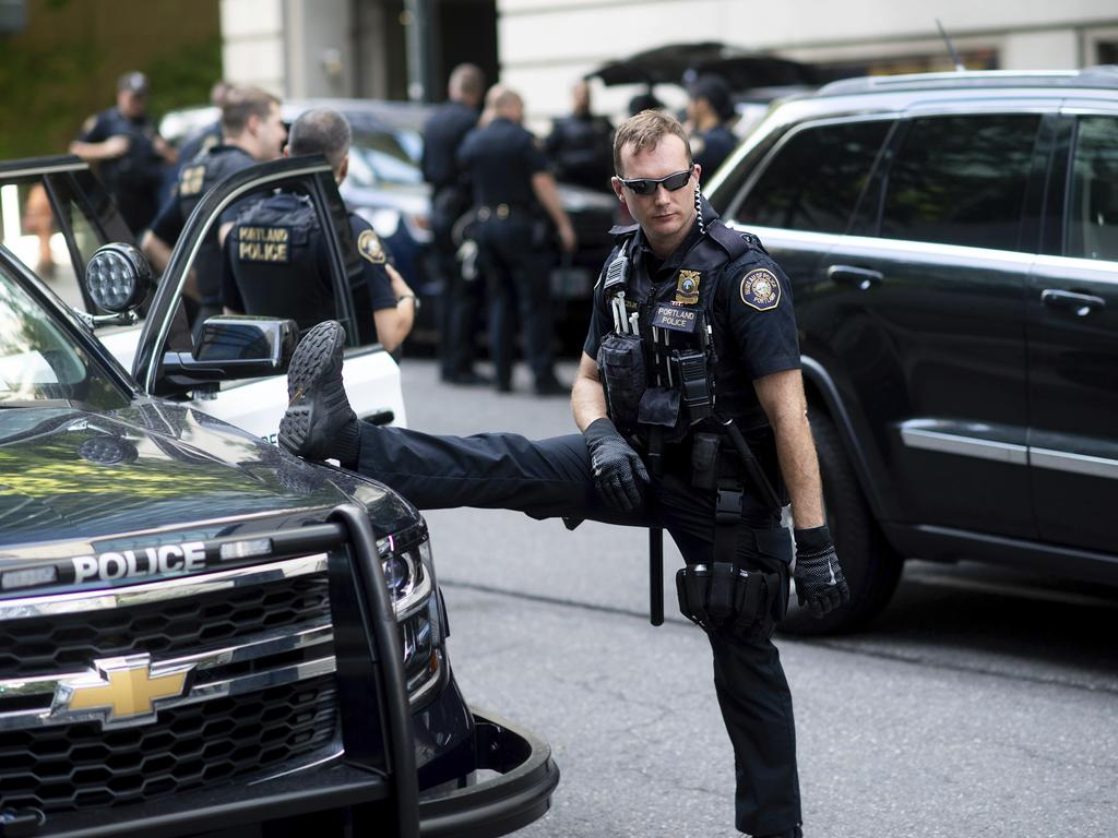 A Portland police officer stretches before the start of a protest in Portland, Oregon. Picture: AP