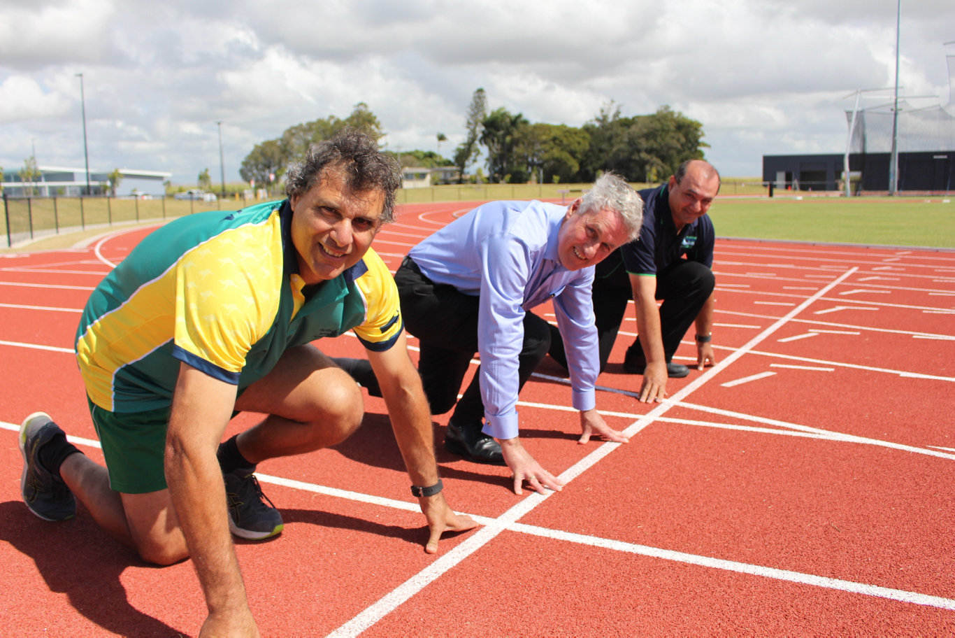Mackay Masters athlete Kevin Galea, Mayor Greg Williamson and joint-chair of the local organising committee James Grech take their marks.