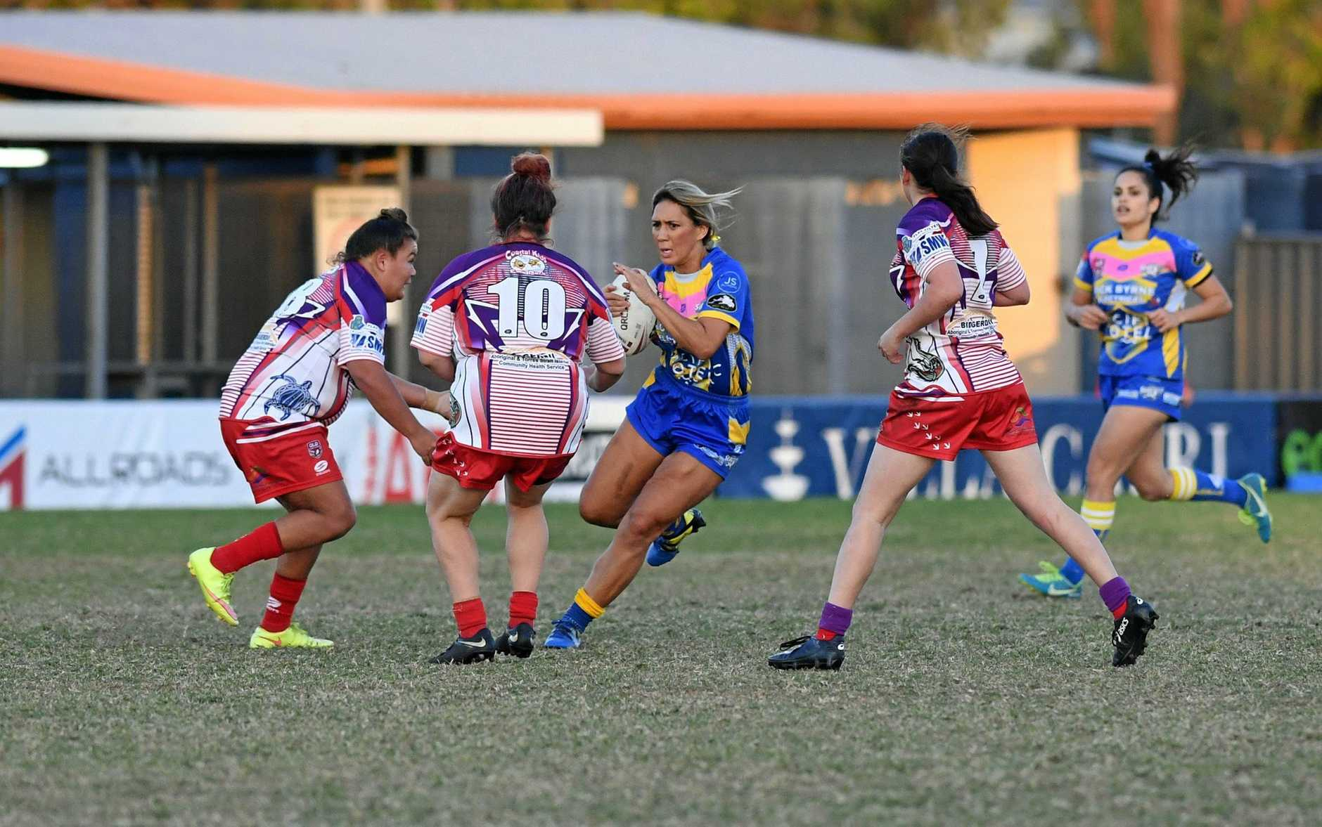 PRESSURE: Yeppoon's Sharni Upton takes on the Emus' defensive line.