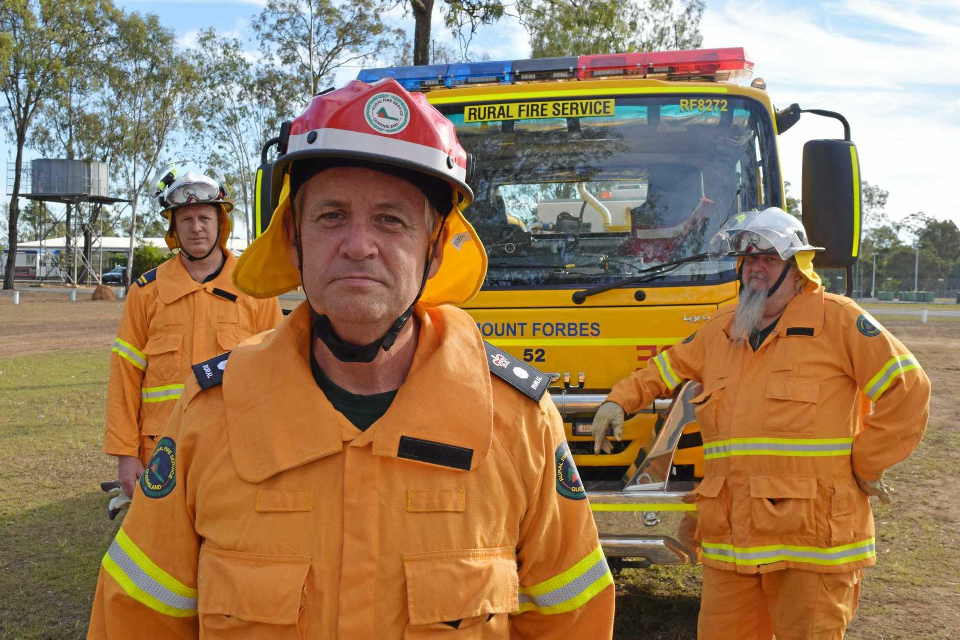 Queensland Rural Fire Service regional manager Superintendent Alan Gillespie (centre), with Mt Forbes Rural Fire Brigade members Jason Gillett (left) and Peter Ackerley.