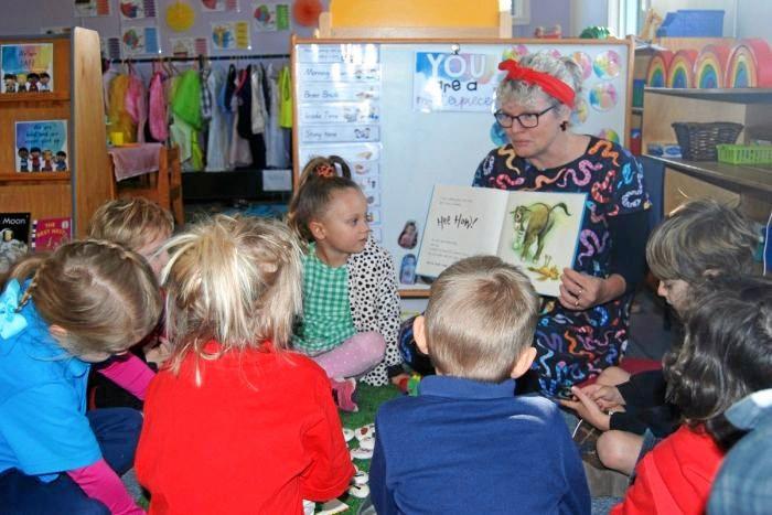 LISTEN UP: Teacher, Debbie Bradfield reads a story at Texas Kindergarten.